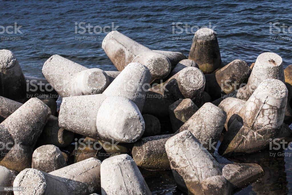 Old concrete blocks of breakwater stock photo