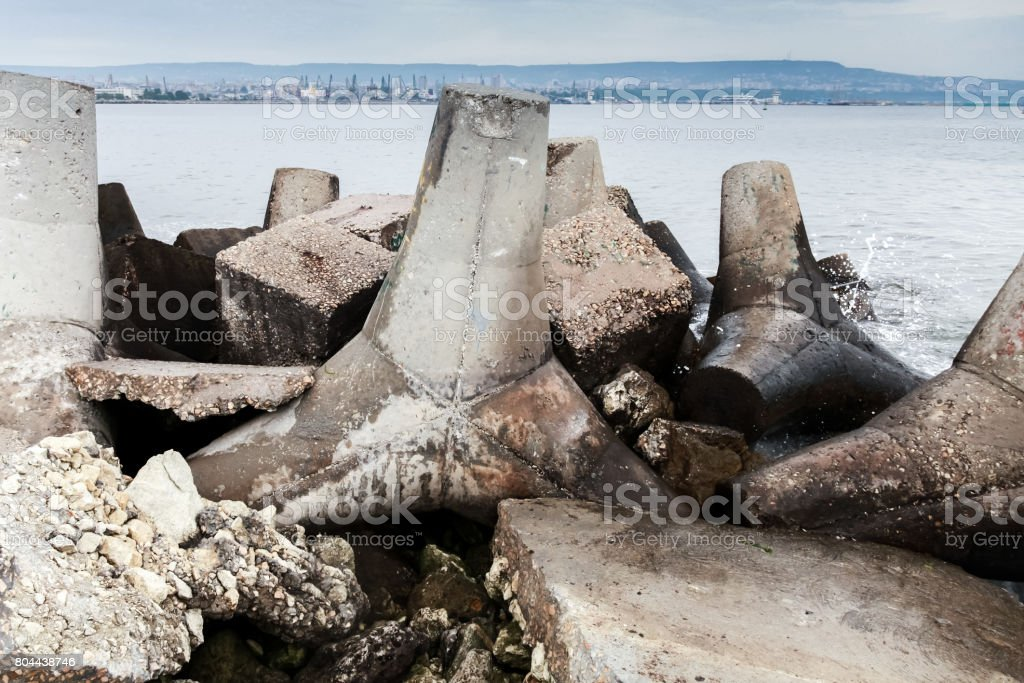 Old concrete blocks of breakwater wal stock photo