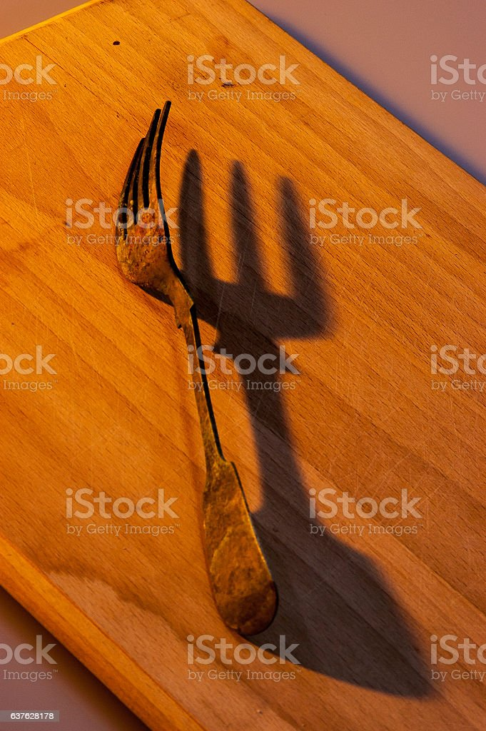 Old copper fork still life showing oxidization and discoloration stock photo