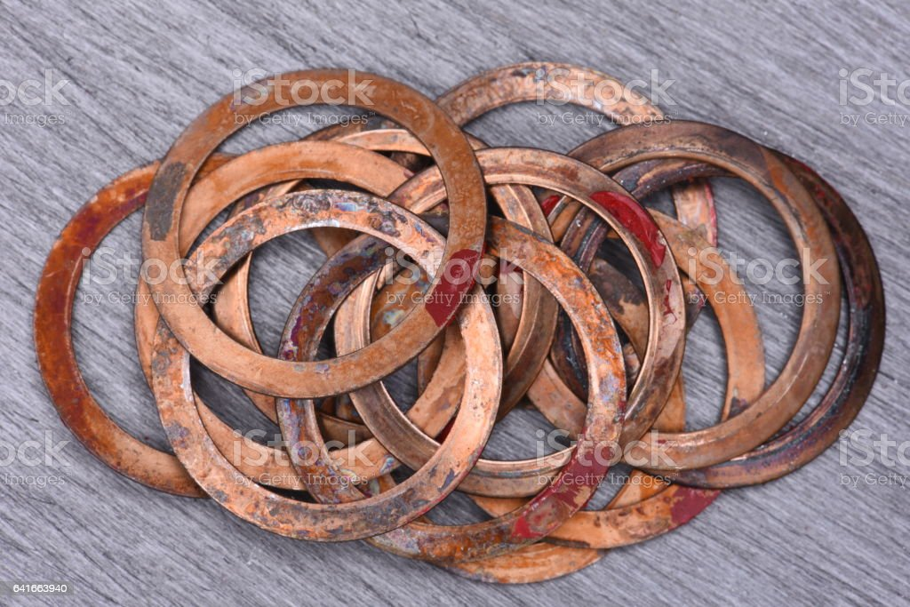 Old Copper Washers on Metal Background stock photo