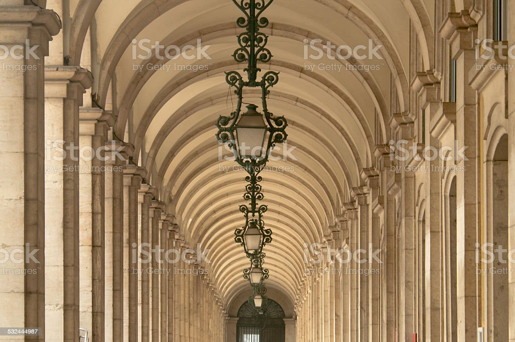 Old corridor with lamps in Lisbon, Portugal stock photo