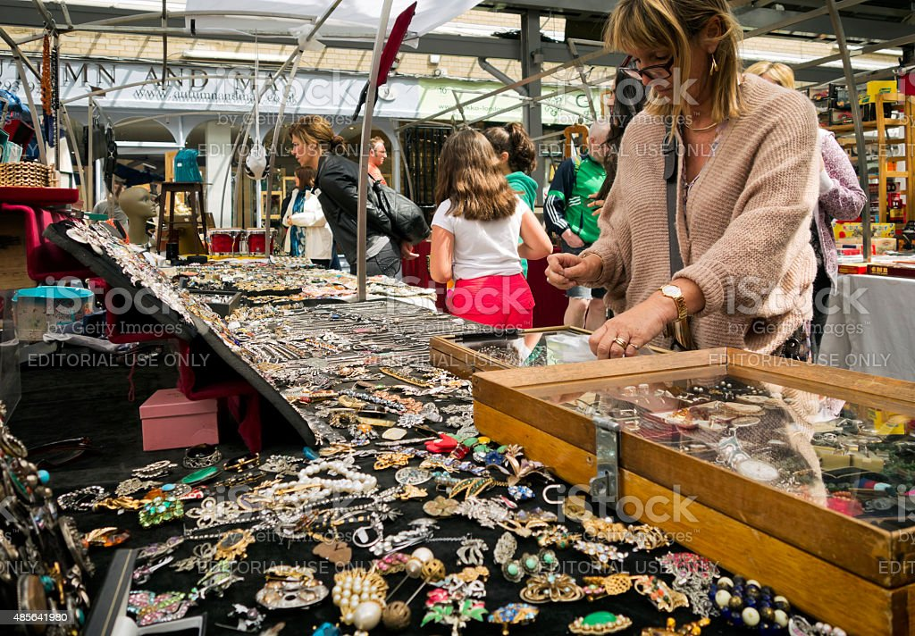 Old costume jewellery stall with customers stock photo