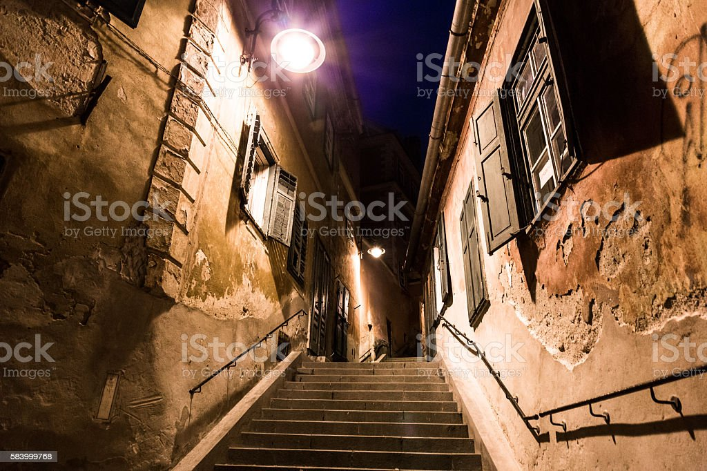 Old cottages and narrow cobblestone alley in Sibiu, Romania stock photo