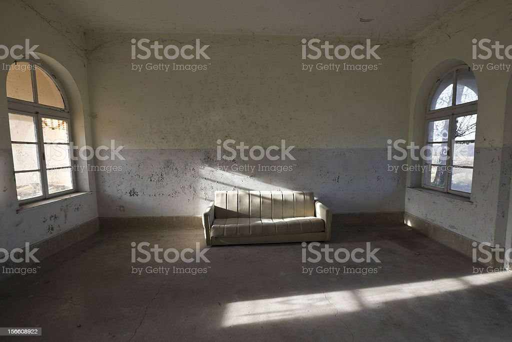 old couch in abandoned train station