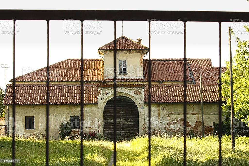 Old country house behind bars royalty-free stock photo