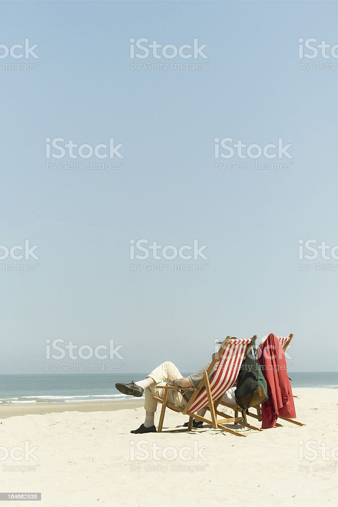 Old couple at the beach royalty-free stock photo