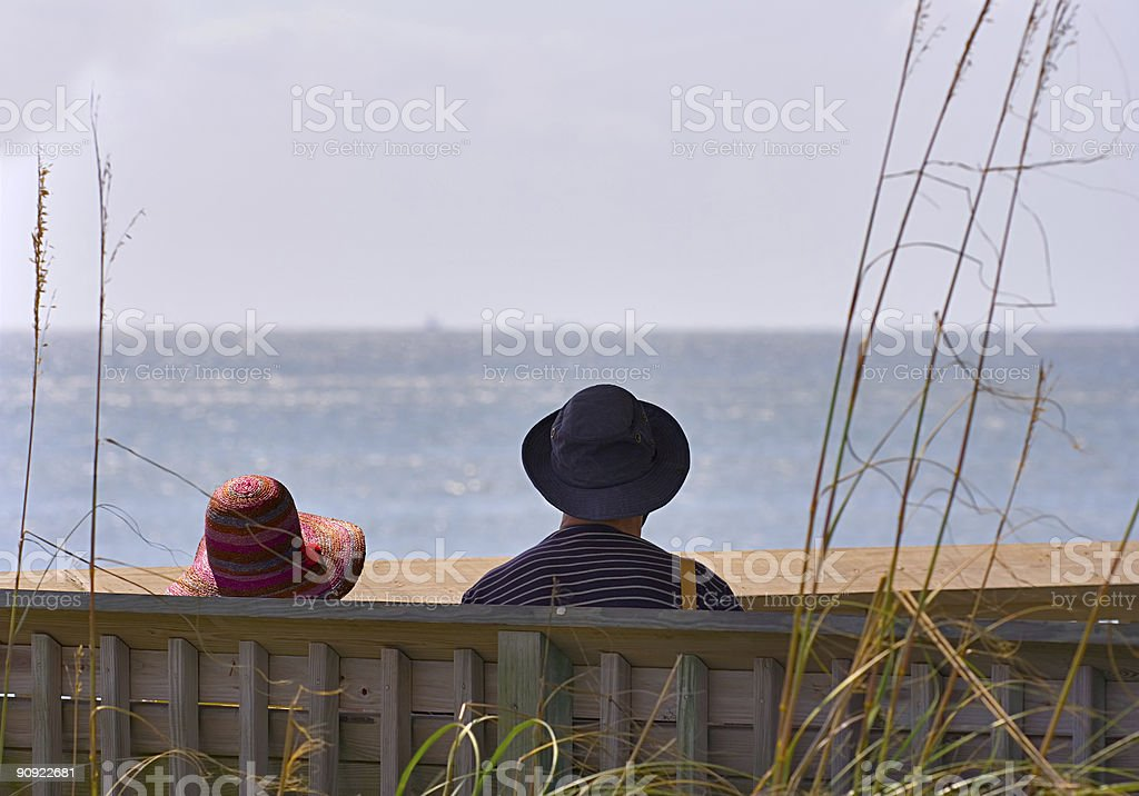 Old couple by the sea royalty-free stock photo