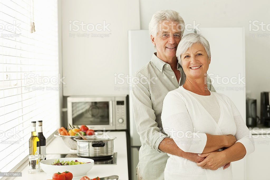 Old couple embracing eachother royalty-free stock photo