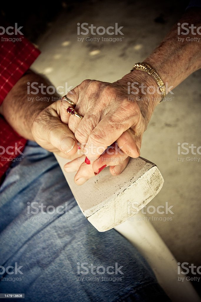 Old couple holding hands royalty-free stock photo