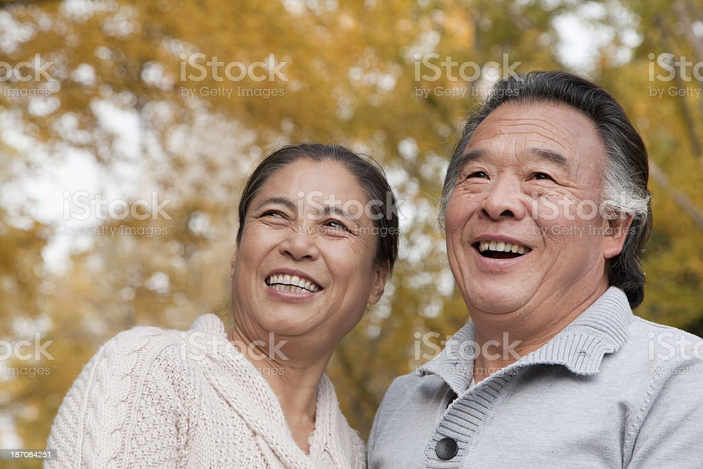 Old couple in park stock photo