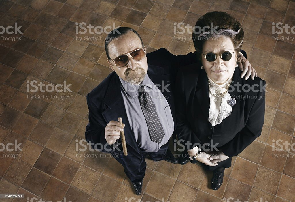 Old couple in suits and sunglasses royalty-free stock photo