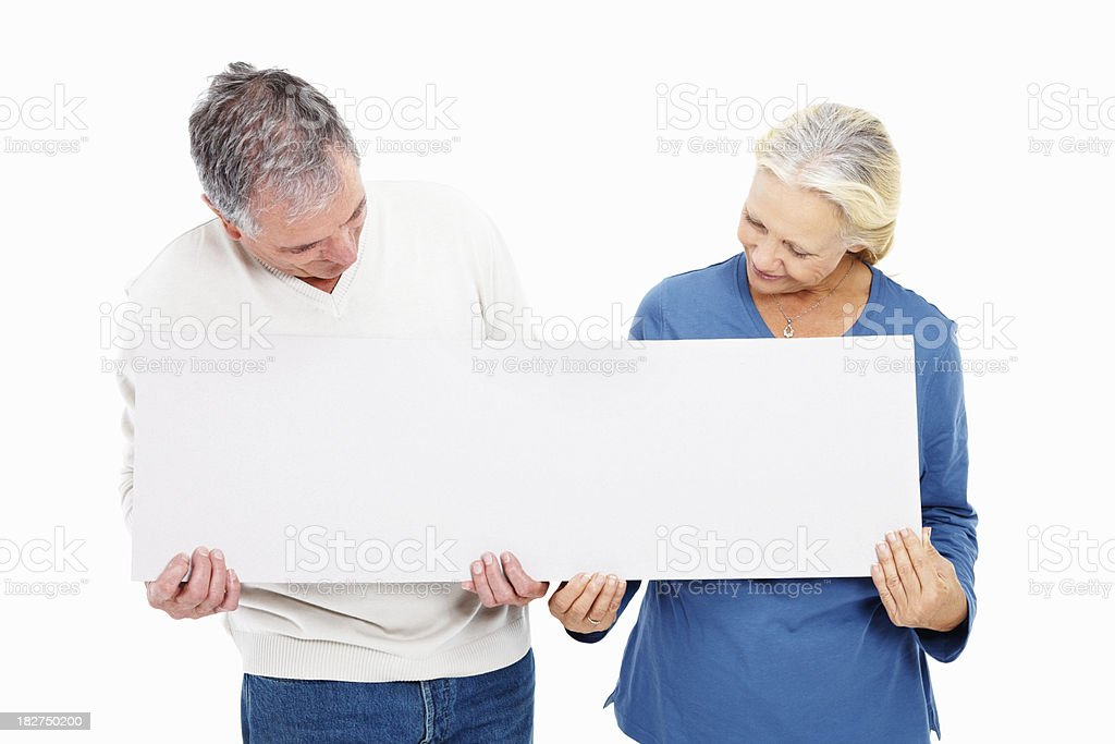 Old couple looking at your text on a billboard royalty-free stock photo