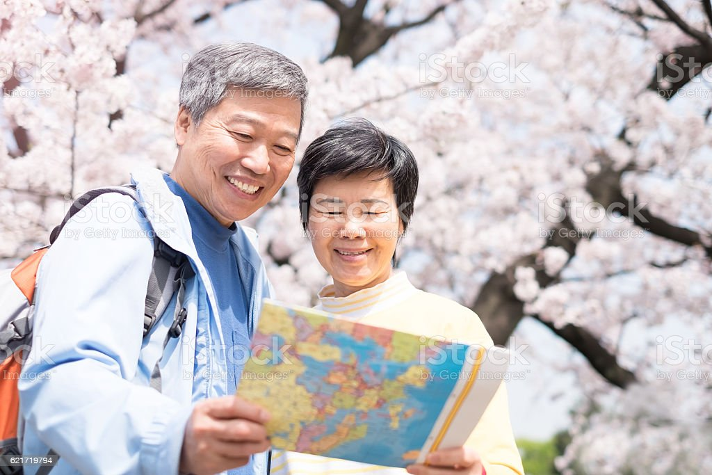 Old couple take map stock photo