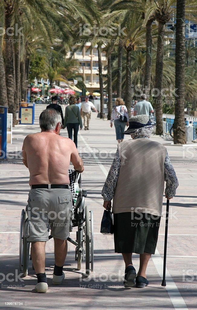 Old couple walking royalty-free stock photo