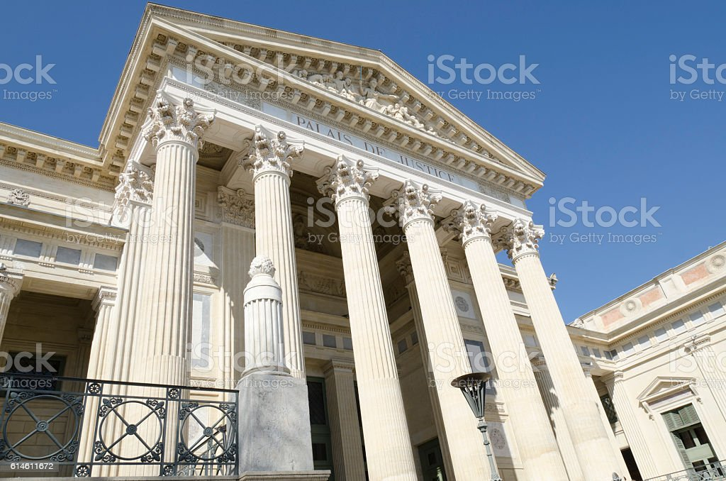 old courthouse with pillars stock photo