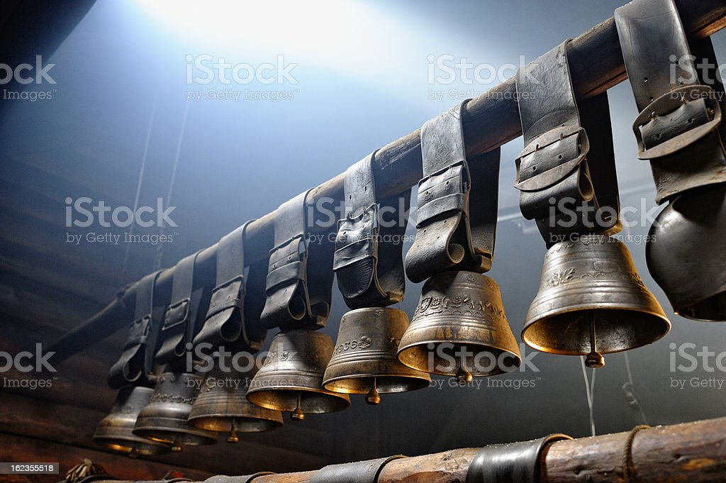 Old Cow Bells in Swiss Farmhouse stock photo