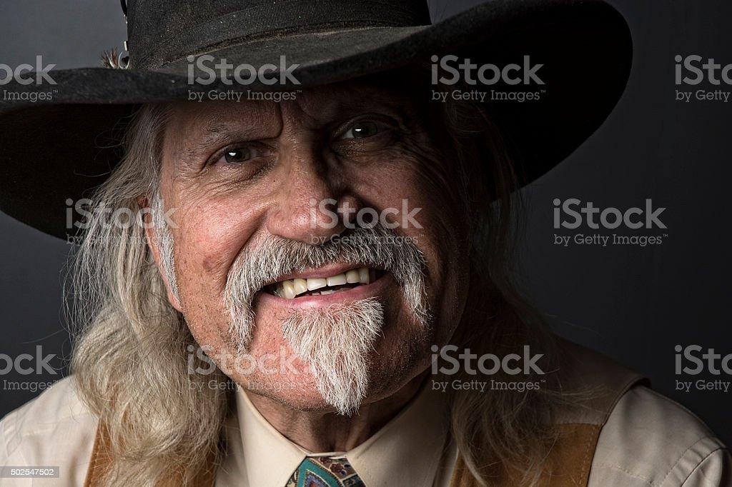 Old Cowboy Goatee Moustache Guy Smiling Headshot Portrait stock photo