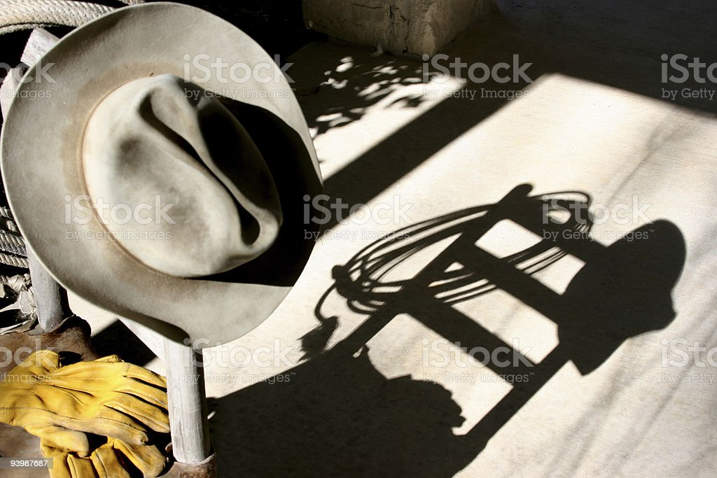 Old cowboy hat and gloves shadow royalty-free stock photo
