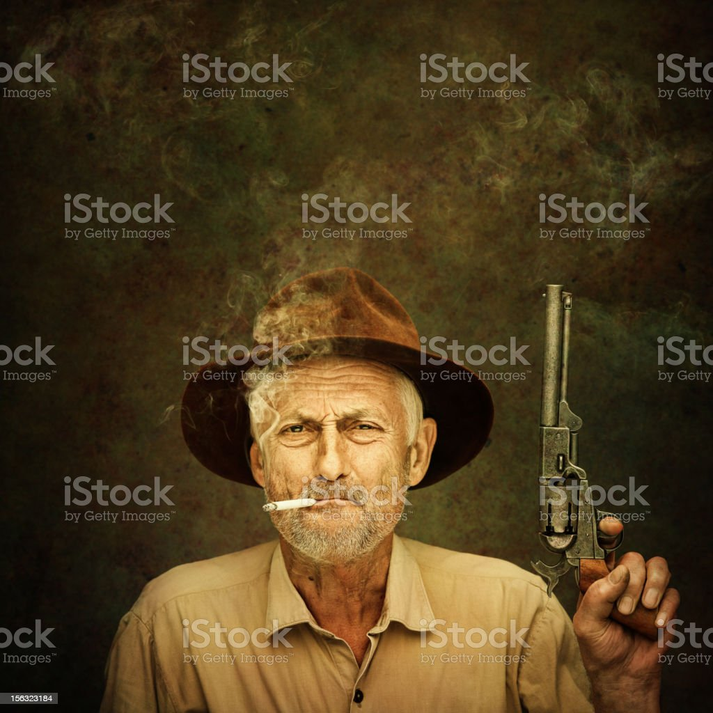 old cowboy with colt stock photo