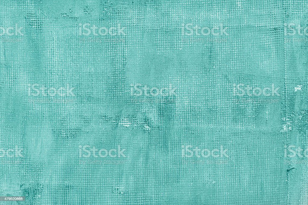 Old cracked concrete mint wall with net, holes, splits, stains stock photo