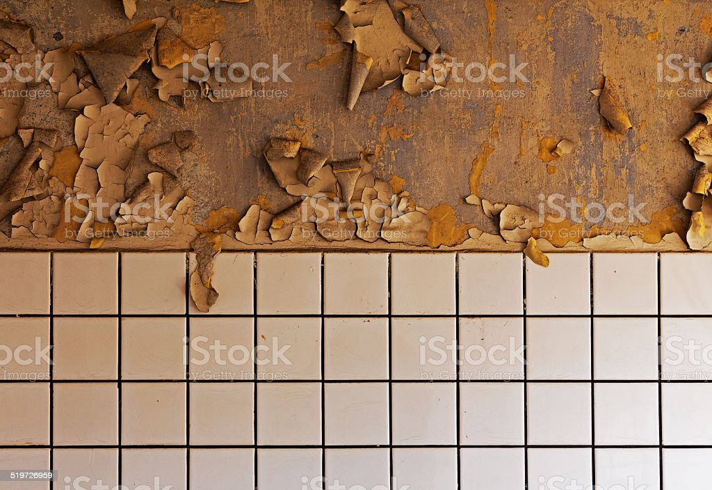 Old cracked dilapidated wall and ceramic tile stock photo