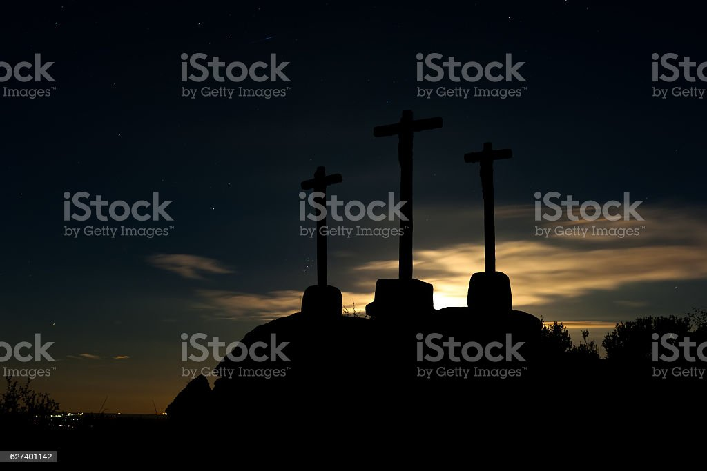 old crosses of stone to the backlight stock photo