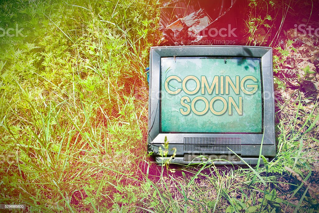 Old CRT television with 'Coming Soon' written on screen stock photo