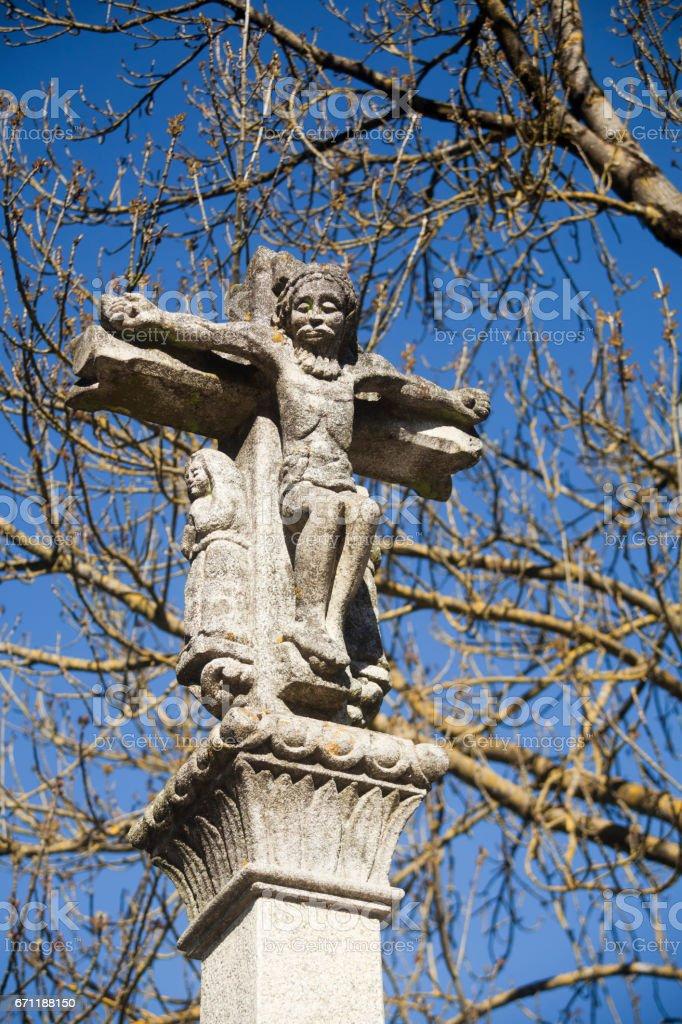 Old cruceiro and oak tree in the 'Camino de Santiago' stock photo