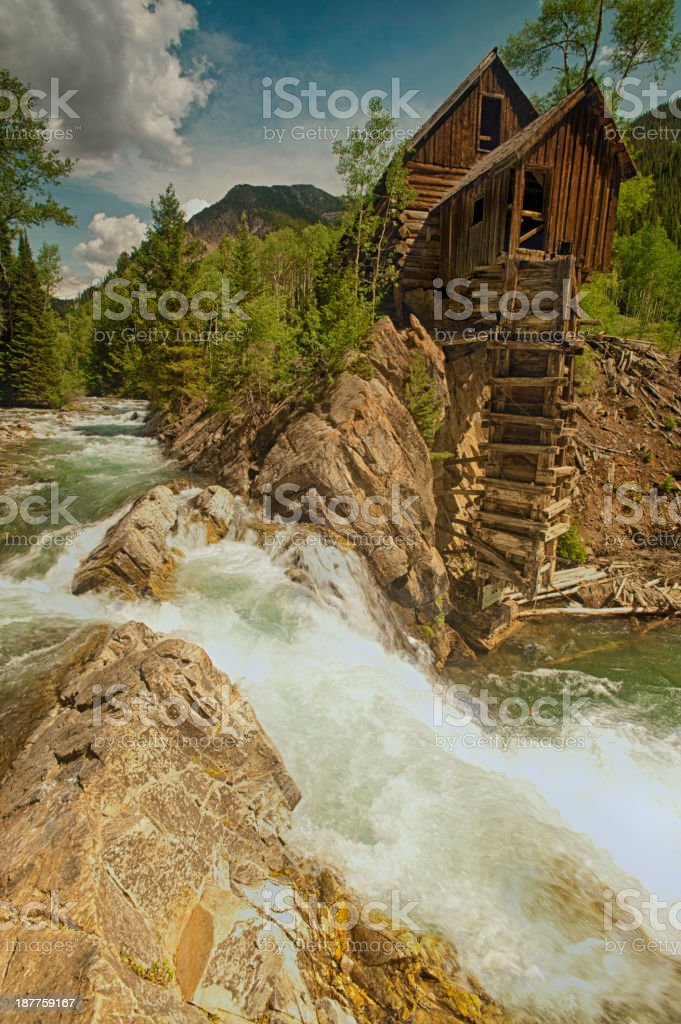 Old Crystal Mill on the river in Colorado royalty-free stock photo