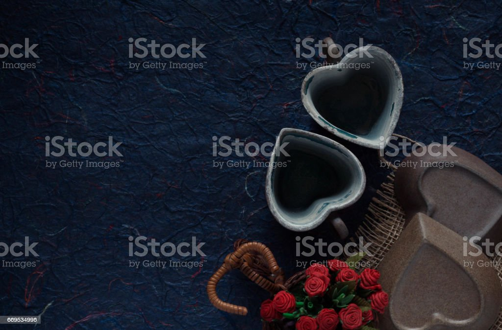 Old cup on blue background. stock photo