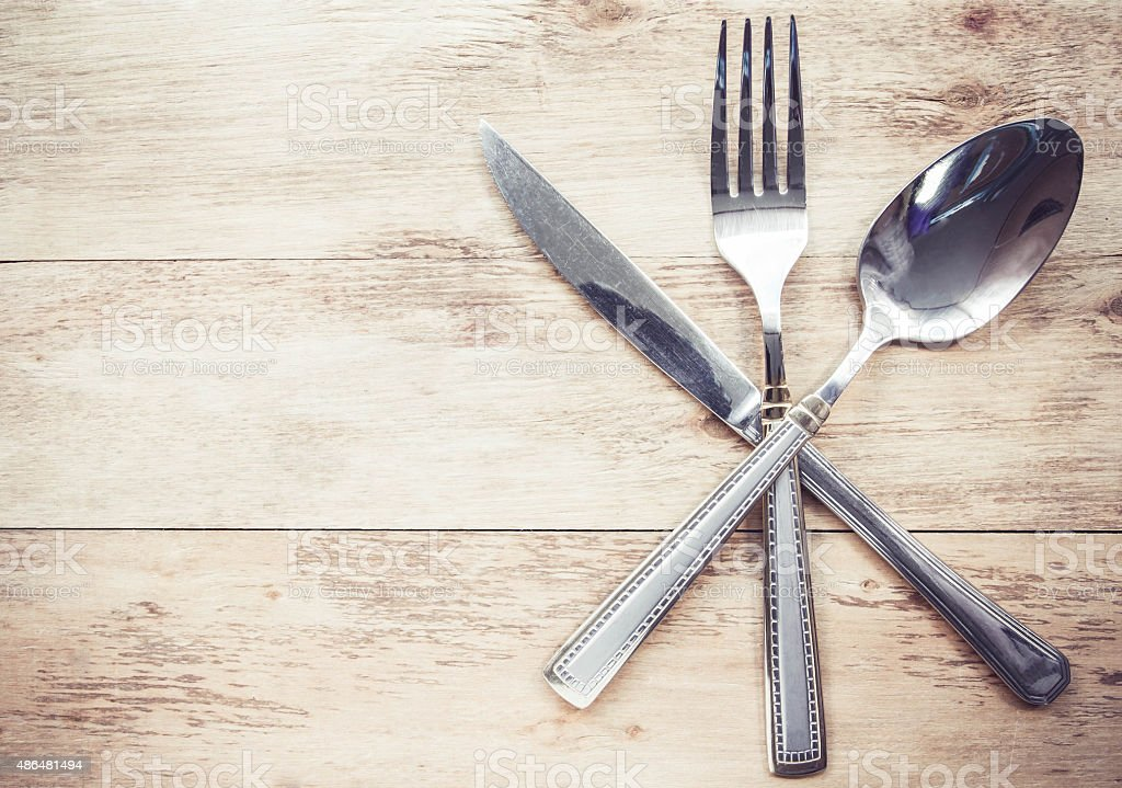 old cutlery on wooden table stock photo