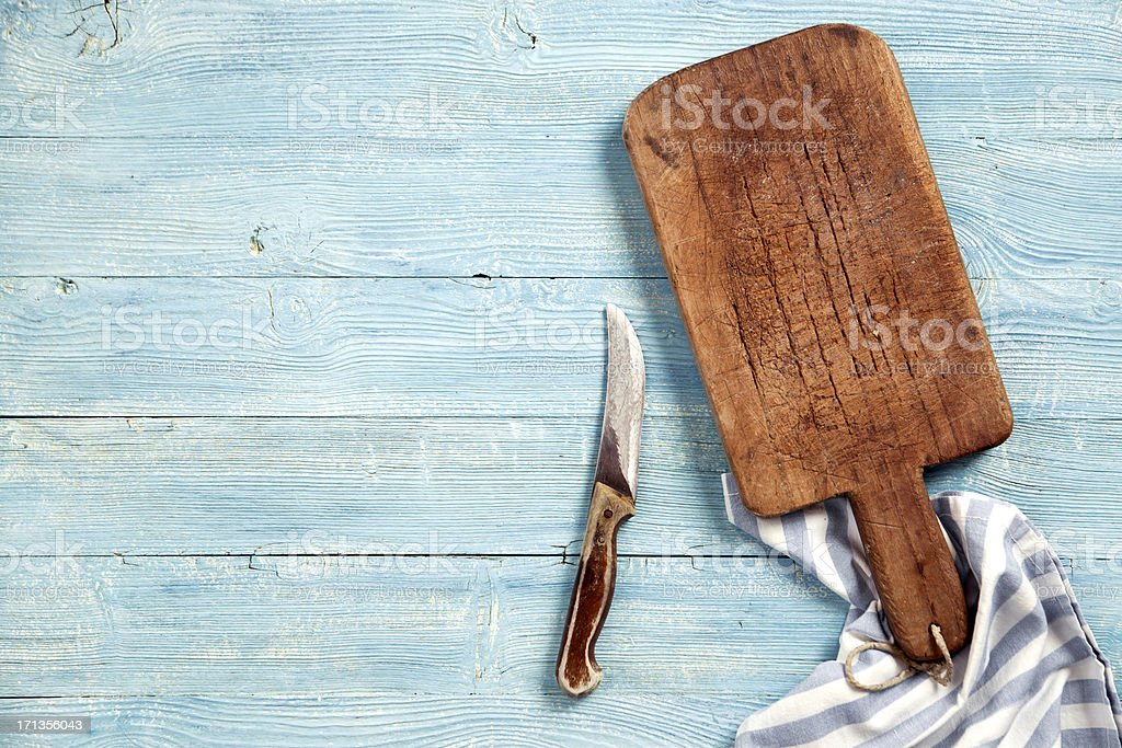 Old cutting board and knife stock photo