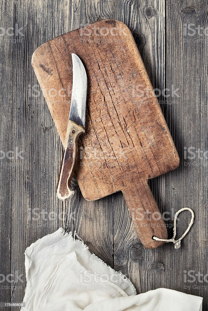 Old cutting board and knife royalty-free stock photo