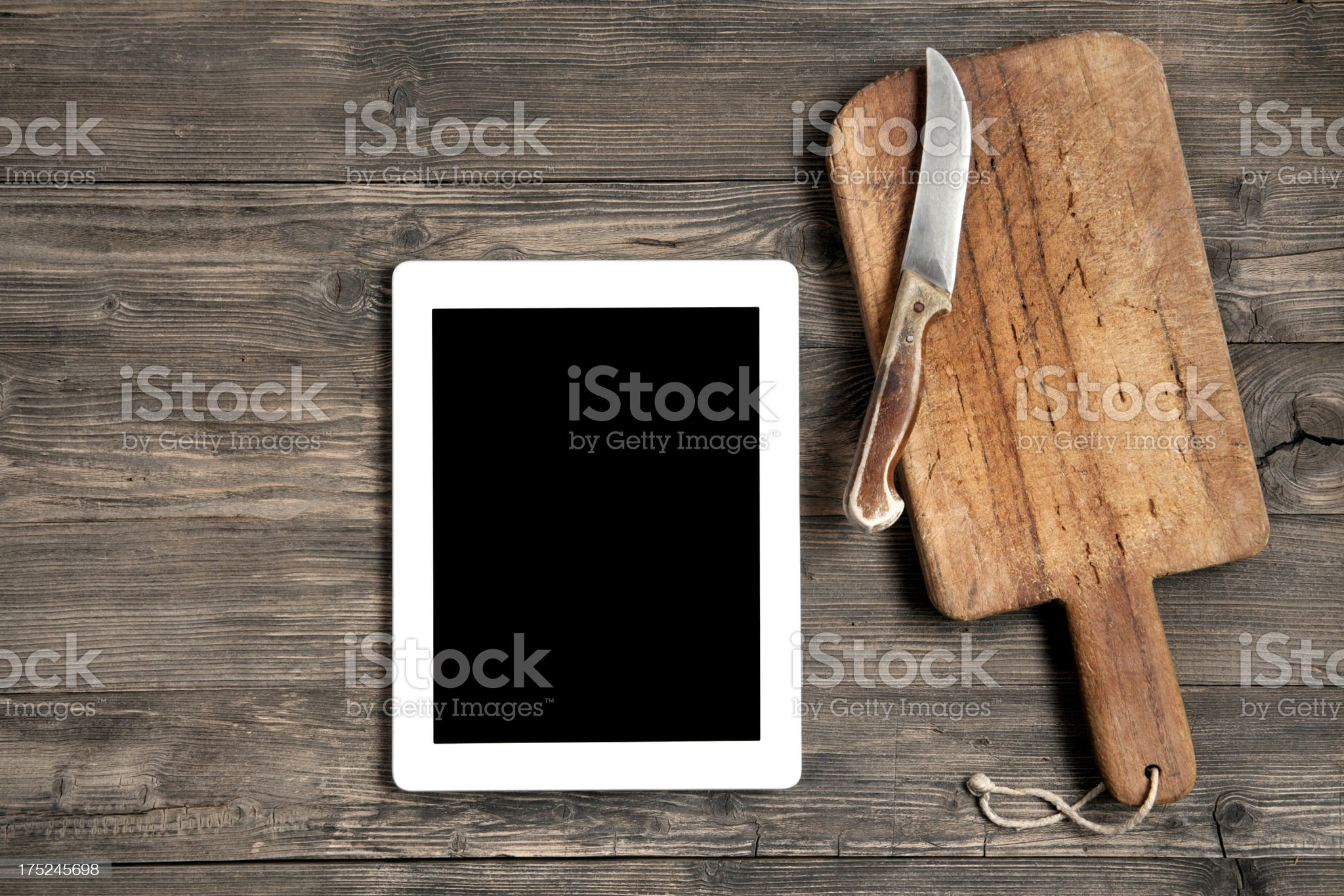 Old cutting board with digital tablet royalty-free stock photo
