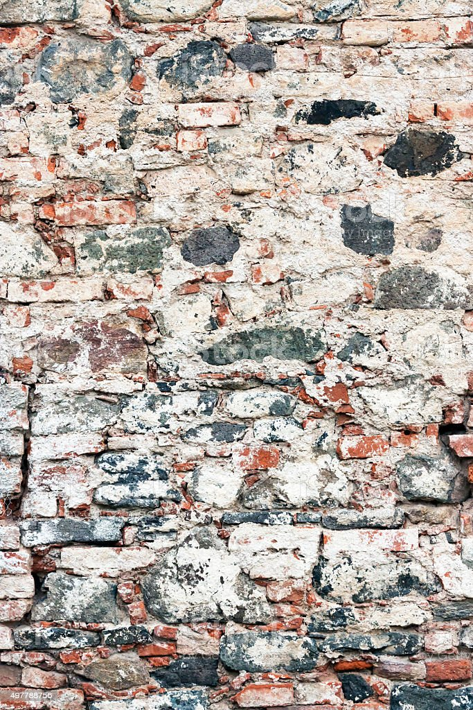 Old damaged brick wall background, copy space stock photo