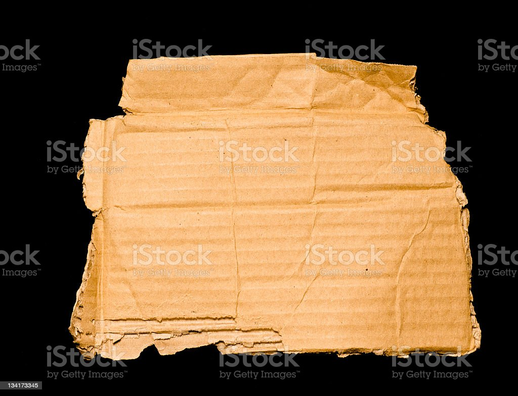 Old Damaged Brown Paper Isolated on Black royalty-free stock photo