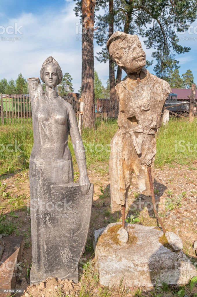 Old damaged park sculptures stock photo