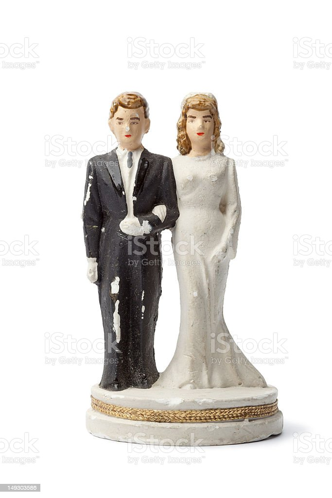 Old damaged plaster bride and groom figurine stock photo
