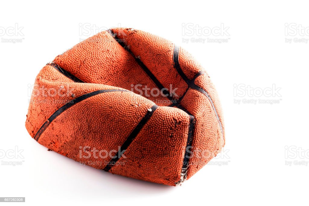 Old damaged rubber basket ball on background stock photo