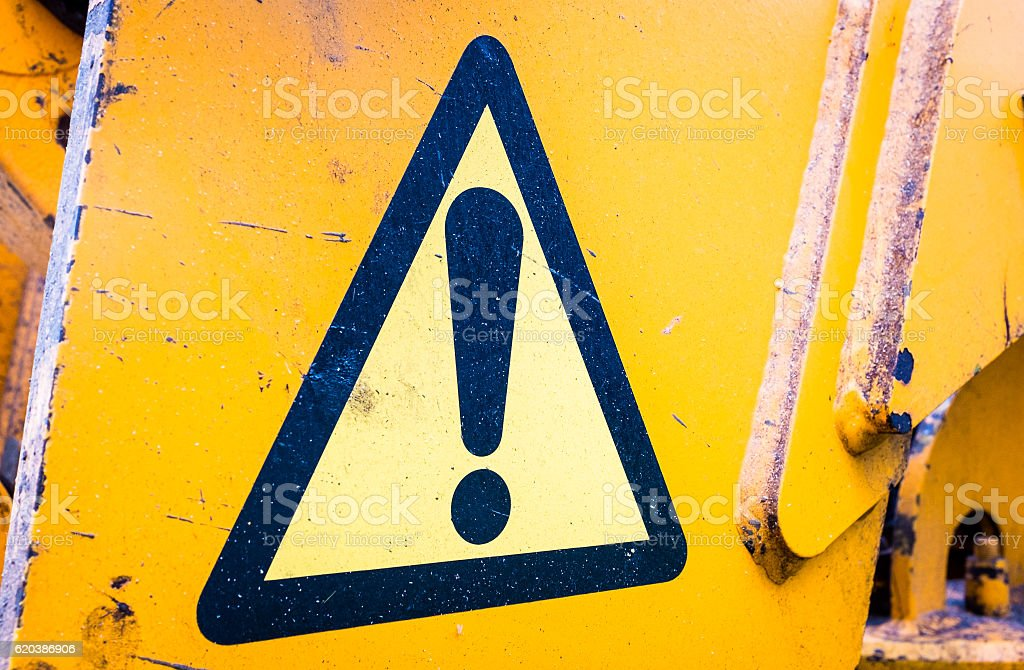 old danger sign stock photo