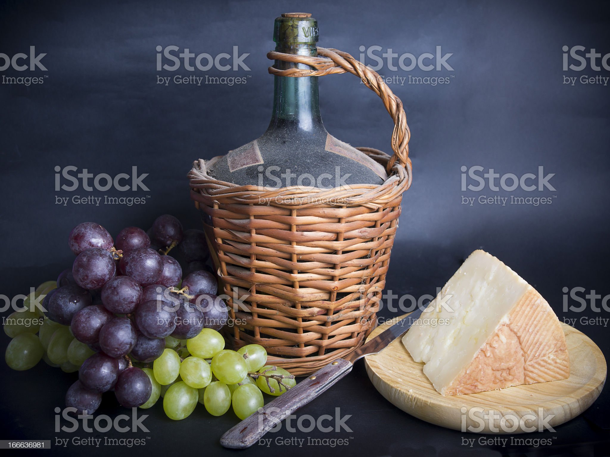 Old Decanter of Red Wine with Grapes and Cheese royalty-free stock photo