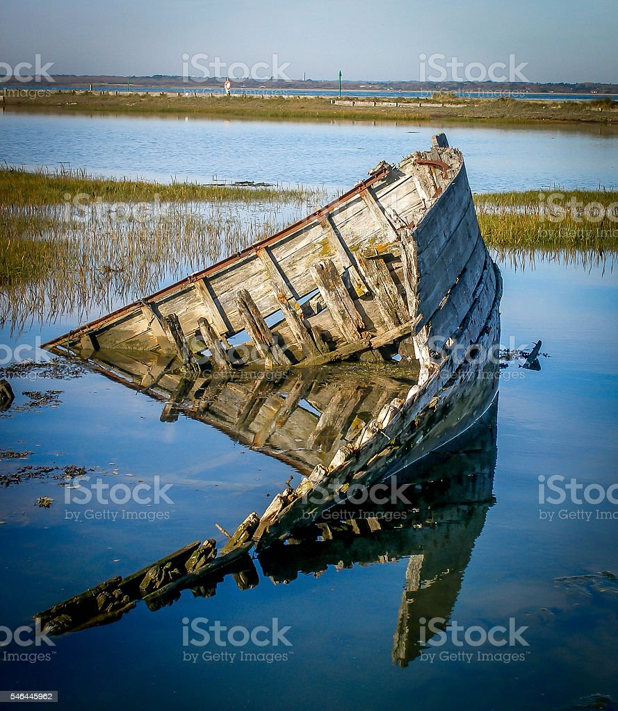 old decaying wooden boat stock photo