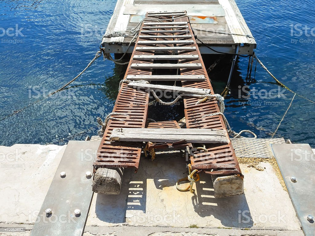 Old decking on the docks in the Sicilian port stock photo