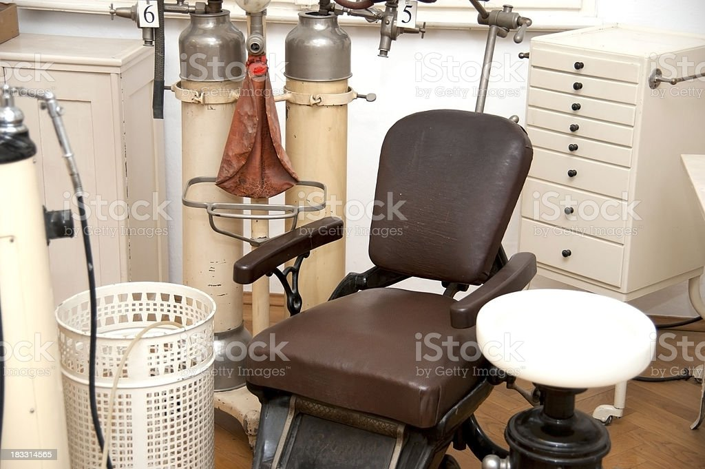 old dentist chair - vintage stock photo