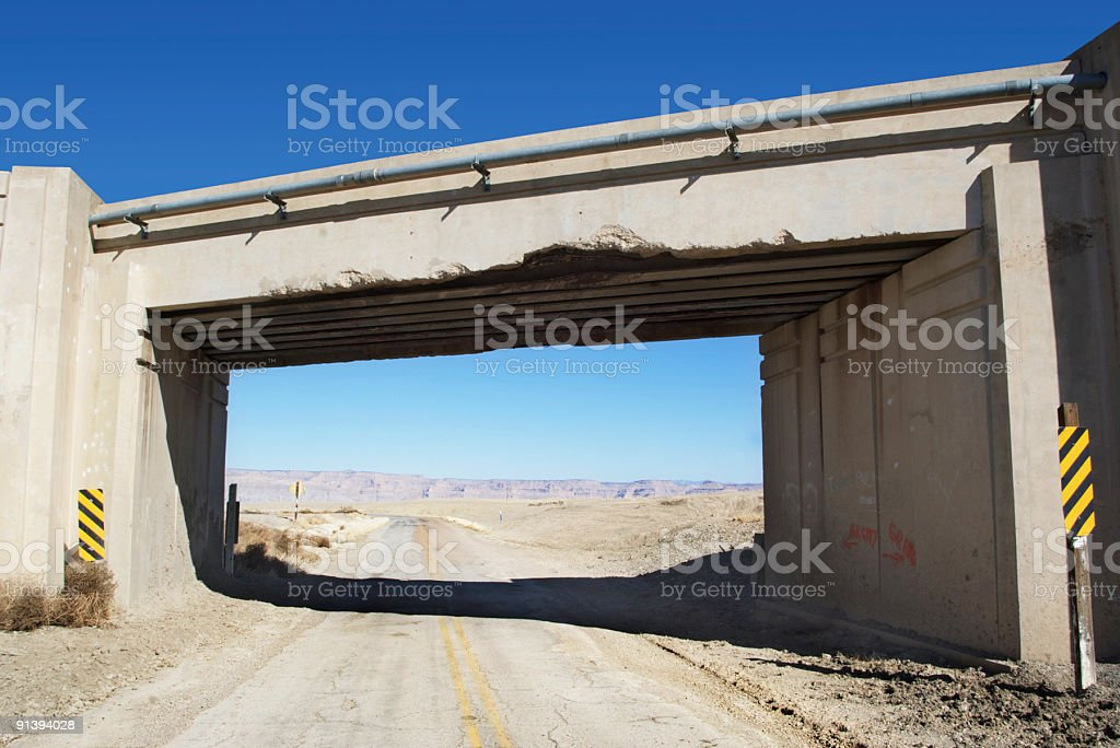 old desert highway and bridge overpass stock photo