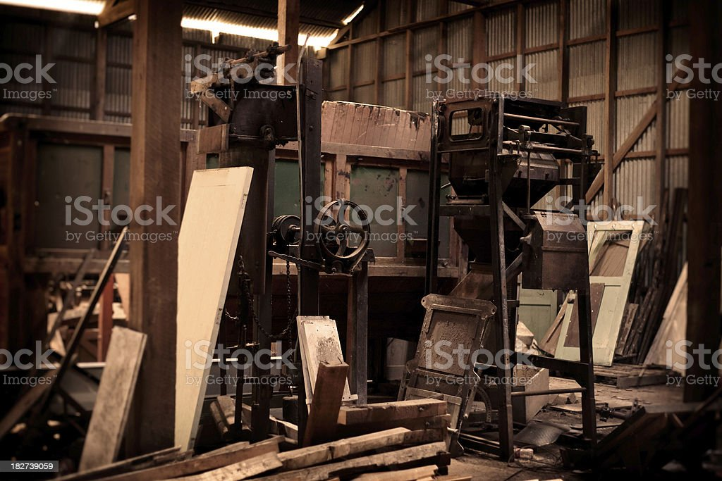 Old deserted Sawmill factory with woodworking Machinery stock photo
