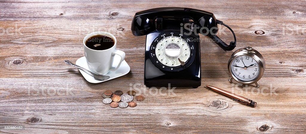 Old desktop with antique business objects on rustic wood stock photo