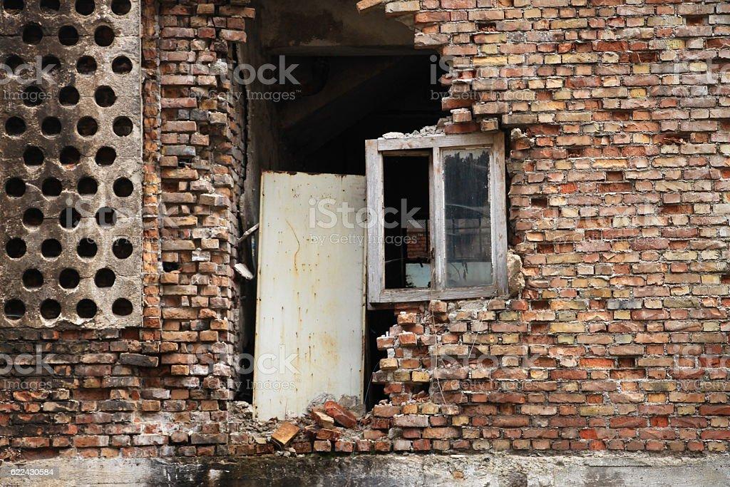 Old destroyed window on brick wall in Sarajevo stock photo