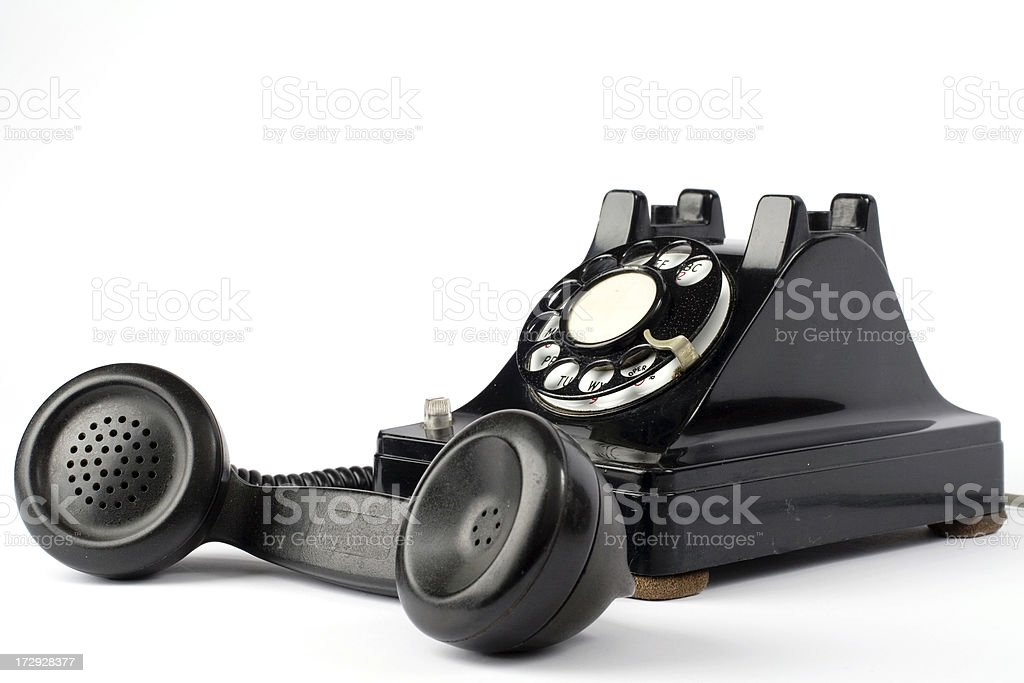 Old dialer phone with handset off hook royalty-free stock photo