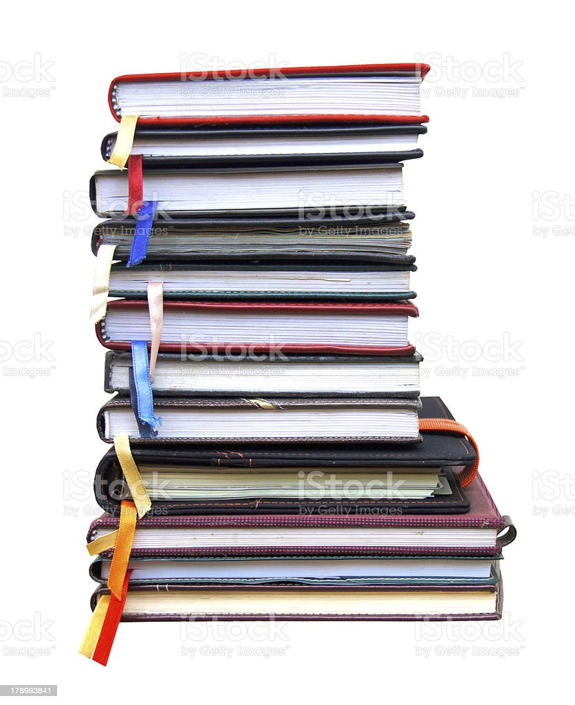 old diary books on white background stock photo
